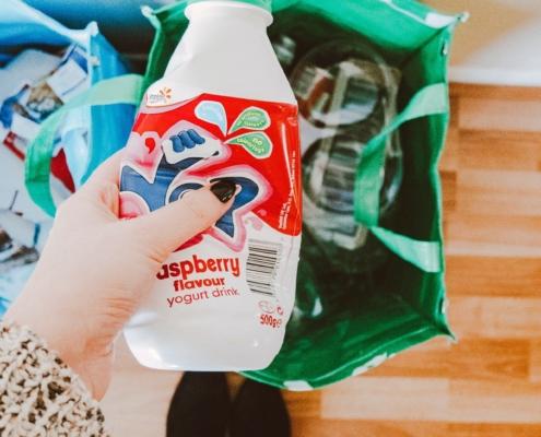 Plastic yogurt bottle being recycled